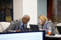 Executive Director Kelly Gottschalk (right) talks with Chairman Sam Friar during the Board of Trustees meeting at Dallas Police and Fire Pension System in Dallas on Dec. 8, 2016.(Jae S. Lee/Staff Photographer)