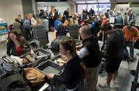 Travelers passed through a TSA security entrance in Terminal C at DFW International Airport on Monday.(Rex C Curry/Special Contributor)