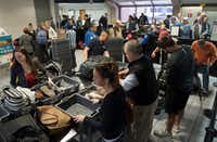 Travelers passed through a TSA security entrance in Terminal C at DFW International Airport on Monday. (Rex C Curry/Special Contributor)