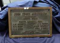 The John Fenet Auditorium plaque was on display after its unveiling at McKinney High School on Monday. (Jason Janik/Special Contributor)