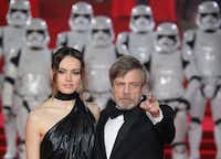 Actors Daisy Ridley, left, and Mark Hamill pose for photographers upon arrival at the premiere of the film <i>Star Wars: The Last Jedi</i> in London. (Vianney Le Caer/Invision/AP)