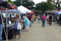 The Four Seasons-Casa Linda Farmers Market sets up in front of Natural Grocers, Savor Patisserie (macarons) and Steel City Pops.(Kim Pierce/Special Contributor)