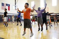 Luis Catalan, 11, does jumping jacks with a group during the Dallas Police Athletic League in this 2016 photo. (Ben Torres/Special Contributor)