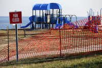 A recreational area is fenced off in an area where high levels of lead were recorded following Superstorm Sandy in Laurence Harbor, N.J.(2012 File Photo/The Associated Press)