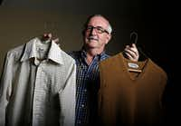 Dale Irby holds the 40-year-old dress shirt and sweater vest that helped launch the retired school teacher to Internet stardom following a story by The Dallas Morning News columnist Steve Blow.(G.J. McCarthy/Staff Photographer)