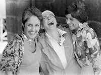 From left: Folk singers Joan Baez, Judy Collins and Mimi Farina (Baez's sister) laugh backstage at the Newport Folk Festival in Newport, R.I., on Aug. 3, 1984.(Ted Gartland/The Associated Press)