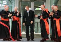 President George W. Bush smiles as he is applauded by Cardinals Bernard Law of Boston (from left),  Edmond Szoka, Adam Maida of Detroit, William Henry Keeler and Theodor McCarrick of Washington, D.C., at the opening of the Pope John Paul II Cultural Center in Washington in 2001. (Luke Frazza/AFP)