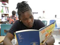 R'reanna Wooten, 11, reads in her fourth-grade writing class at George W. Carver Creative Arts Learning Center.(David Woo/Staff Photographer)