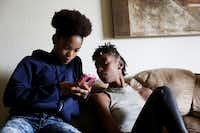 <p>Kylia Booker (right) watches younger sister Ja'Bria Roland while spending time at her sisters' home in Denton. Throughout their lives, the sisters in this family endured foster care, bounced between relatives and toughed it out on their own when their mom went to jail. </p>(Andy Jacobsohn/Staff Photographer)