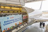 Toys loaded onto a Hillwood Airways plane that will deliver 30,000 Hasbro toys and Games to children in Puerto Rico through the Marine Toys for Tots program. The toys and the plane carrying them were donated.(Debra Hale/Hillwood)