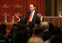 <p>AT&T CEO Randall Stephenson speaks at an Economic Club of New York luncheon Nov. 29. The Dallas-based company announced Wednesday that once the tax code overhaul was signed into law, it would pay a special $1,000 bonus to more than 200,000 AT&T U.S. employees.</p>(Spencer Platt/Getty Images)