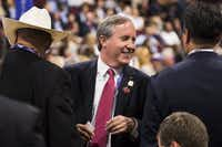 In this 2016 file photo, Ken Paxton chats with the Texas delegation at the Republican National Convention in Cleveland. (Smiley N. Pool/Staff Photographer)