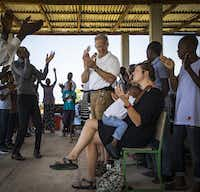 Jacklyn Vanderpool holds a child in her lap as she worships with her father, Dr. David Vanderpool (center), during church services at the LiveBeyond compound on Aug. 27, 2017, in Thomazeau, Haiti. (Smiley N. Pool/Staff Photographer)