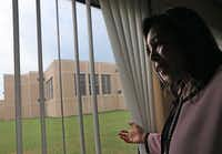Terry Smith, director of Dallas County Juvenile Department, looks out the window at the Jerome McNeil Jr. Detention Center. (Louis DeLuca/Staff Photographer)