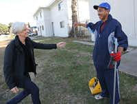 The Human Impact advocate Jennifer Jorns greets Willie Hodge as she stops by to visit him on the job.(Louis DeLuca/Staff Photographer)