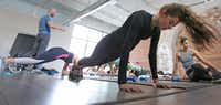 """<p><span style=""""font-size: 1em; background-color: transparent;"""">Dallas fitness trainer John Benton, who has been dubbed the """"hips whisperer"""" for his uncanny ability to get his clients into unbelievable shape, holds a class in Dallas.</span></p>(Louis DeLuca/Staff Photographer)"""
