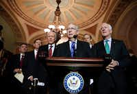 Senate Majority Leader Mitch McConnell of Kentucky spoke after a caucus luncheon, with (from left) Sens. Cory Gardner, R-Colo.; John Barrasso, R-Wyo.; Orrin Hatch, R-Utah; John Thune, R-S.D.; and John Cornyn, R-Texas, on Tuesday.(Alex Brandon/The Associated Press)