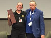 Veteran photographer Kenneth Brock (left) received the DFW Veteran Entrepreneur of the Year 2017 award from Jim Reid, president of Momentum Texas, at the Texas Veterans Business Summit Nov 3 at the Federal Reserve Bank of Dallas.(MTI)
