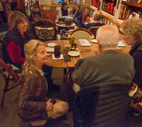 Hedda Dowd kneels to chat with a table of long-time regulars in her Inwood Village restaurant Rise Soufflé Salon in Dallas, Texas on December 20, 2017. (Robert W. Hart/Special Contributor)(Robert W. Hart/Special Contributor)
