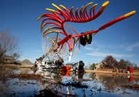 "A memorial sculpture, still under construction, titled ""Phoenix"" designed by Troy Connatser sits in the backyard of a home in Rowlett on Thursday.(Rose Baca/Staff Photographer)"