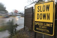<p>A homeowner along Abrams Road in Lakewood posted a sign urging drivers to obey the speed limit.</p>(Louis DeLuca/Staff Photographer)