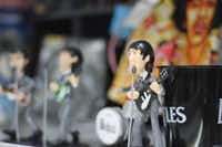 The inside of The Beatles shop is filled with paraphernalia to Ricardo Calderon's favorite band, including figurines made out of clay and wood made in Mexico.(Alfredo Corchado/The Dallas Morning News)