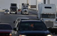 Tractor trailers roll along the highway in Miami.(Joe Raedle/Getty Images)