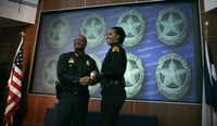 Then-Police Chief David Brown presented a deputy chief badge to Catrina Shead in July 2012. Shead commanded the northwest patrol division before being demoted recently to major to oversee the central patrol division. (Evans Caglage/Staff Photographer)