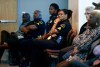 Dallas officers listened last month at a news conference as Hall announced the new command structure.(Rose Baca/Staff Photographer)