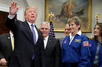 "President Donald Trump signed Space Policy Directive 1 this month during a ceremony with NASA astronauts including Peggy Whitson (second from right). On the 45th anniversary of Apollo 17 — the last crewed mission to the moon — Trump signed the order directing NASA ""to lead an innovative space exploration program to send American astronauts back to the moon, and eventually Mars,"" according to White House spokesman Hogan Gidley. (Chip Somodevilla/Getty Images)"