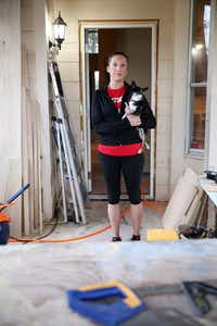 Laura Reed, with her dog Toby, and her husband didn't get flood insurance when they bought their Katy home six years ago. And they're still trying to rebuild from damage caused by Hurricane Harvey.(Rose Baca/Staff Photographer)