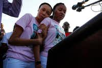 Shavon Randle's sisters Kayla Randle, 14, (right) and Shiniece Richards, 16, speak during a vigil for their sister who was killed and left in an abandoned home in Dallas.(Nathan Hunsinger/Staff Photographer)