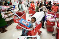 Kei'veericky Simmons, 3, one of the sons of slain Dollar General clerk Gabrielle Monique Simmons, rode in a full shopping basket during the shopping spree.(Smiley N. Pool/Staff Photographer)