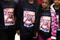 """<p>Nevaeh Simmons (second from right), 5, the daughter of slain Dollar General clerk Gabrielle Monique Simmons, joined her siblings during a shopping spree Friday in the Red Bird area. All<span style=""""font-size: 1em; background-color: transparent;"""">wore black shirts with their mom's photo on the front.</span></p>(Smiley N. Pool/Staff Photographer)"""