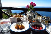 Fresh fruit, a heaping bread basket, and Sfogliatella Santa Rosa pastries -- a specialty for which the convent's nuns were renowned -- accompany every breakfast at Monastero Santa Rosa. (Amy Laughinghouse/Special Contributor)