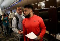 Dallas Cowboys quarterback Dak Prescott talks to running back Ezekiel Elliott during locker room clean out at The Star in Frisco, Texas on Jan. 16, 2017. (Rose Baca/The Dallas Morning News)