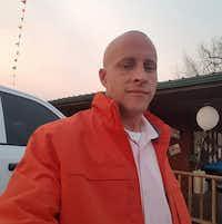 Ryan Hansen, 39, died Saturday after his tire exploded, injuring his head. (David Perkins)