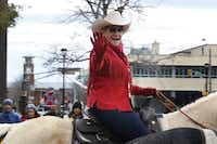 "Fort Worth Mayor Betsy Price waves to supporters during the Fort Worth Stock Show ""All Western Parade"" in downtown Fort Worth, Texas on Saturday, January 16, 2016. Several thousand spectators came out to witness the horse clubs, covered wagons, and marching bands.(Lawrence Jenkins/Special Contributor)"