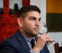Andrew Schawel, beverage director and sommelier for the French restaurant Bullion, participated in the winter wine panel at Tina Danze's house.(Ron Baselice/Staff Photographer)