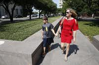 Amber Briggle walks to enter the courtroom with her transgender son MG Briggle, 8, where a hearing for the federal lawsuit on transgender bathroom rules will be held at Eldon B. Mahon U.S. Courthouse in Fort Worth on Aug. 12, 2016. (Nathan Hunsinger/Staff Photographer)