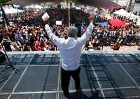 In this April, 2017 photo, presidential hopeful Andres Manuel Lopez Obrador raises his arms during a campaign rally in Atizapan de Zaragoza, Mexico. (Marco Ugarte/The Associated Press)