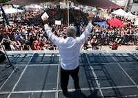 In this April, 2017 photo, presidential hopeful Andres Manuel Lopez Obrador raises his arms during a campaign rally in Atizapan de Zaragoza, Mexico.(Marco Ugarte/The Associated Press)