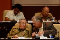Cuban president Raul Castro and Cuban First Vice president Miguel Diaz-Canel talk during the 10th and last regular session of the eighth Legislature of the National Assembly of Popular Power, at the Convention Palace in Havana, on Dec. 21, 2017. Cuban President Raul Castro will step down in April 2018 after elections that same month to choose his successor. The elections will now take place on April 19. Castro, 86, will hand over power shortly afterward to the president-elect. (Agence France-Presse)