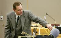 "<p>Dr. Jeffrey Barnard testifies <span style=""font-size: 1em; background-color: transparent;"">during the January 2002 murder trial of ""Texas 7"" escapee Donald Newbury </span><span style=""font-size: 1em; background-color: transparent;"">about the gunshot wounds that killed Irving police Officer Aubrey Hawkins on Christmas Eve 2000. Newbury was sentenced to death and was executed in February 2015.</span></p>(2002 File Photo/Staff)"