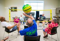 Dan Smith, center, plays chair volleyball with other seniors in September, 2016 at the Carrollton Senior Center in Carrollton.(Staff/2016 File Photo)