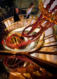 The <i>Necklace of Dreams</i> sculpture by Jean-Michel Othoniel lines the circular staircase at the French restaurant Bullion in downtown Dallas.(Tom Fox/Staff Photographer)