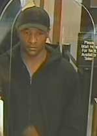 The robber fled with an undisclosed amount of money.(Dallas Police Department)