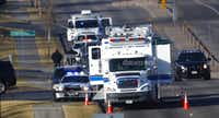 An investigator heads to the scene of shooting Sunday in Highlands Ranch, Colo. Authorities in Colorado say one deputy died and multiple others were wounded, along with two civilians, in a shooting that followed a domestic disturbance in a suburb outside of Denver. (David Zalubowski/The Associated Press)