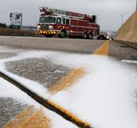 Ice covered part of the overpass of U.S. Highway 67 over Hampton Road in Dallas on Sunday. Dallas Fire-Rescue was waiting for sand trucks. (Irwin Thompson/Staff Photographer)