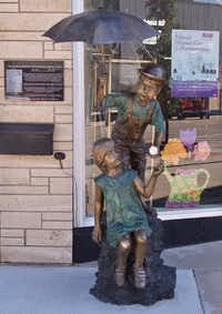 Siblings Elmer and Ethel Barney, who rode the orphan train to a new home in Iowa, are the subjects of one of dozens of orphan train statues positioned around Concordia, Kan.(Bruce N. Meyer/Special Contributor)